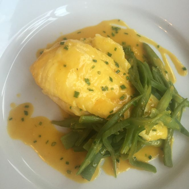 Plaice served with new potatoes and greens with a saffron sauce
